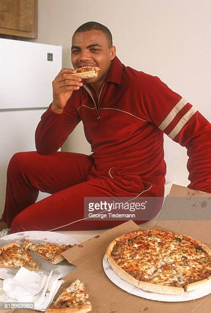 Casual portrait of Auburn Charles Barkley eating pizza during photo shoot Auburn AL CREDIT George Tiedemann