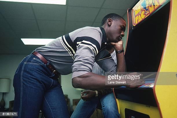 College Basketball Casual portrait of North Carolina Michael Jordan playing MS PACMAN video arcade game at University of North Carolina Chapel Hill NC