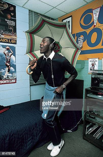 College Basketball Casual portrait of North Carolina Michael Jordan dancing with umbrella in dorm room at University of North Carolina campus Chapel...