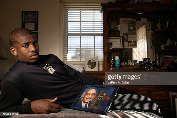 Casual portrait of Wake Forest point guard Chris Paul posing in his bedroom during photo shoot at home. Winston-Salem, NC 1/25/2005 CREDIT: Jeffery...