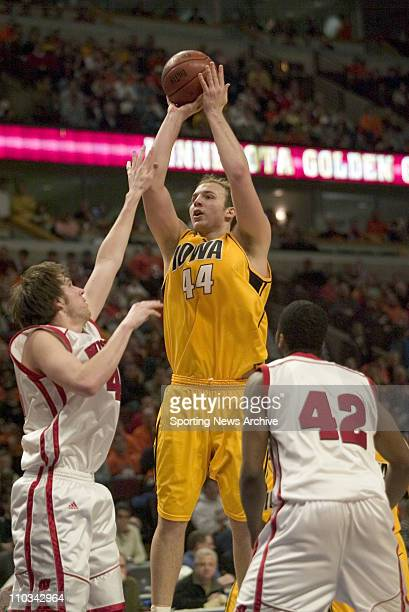 College Basketball Championship Wisconsin Zach Morley Alando Tucker against Iowa Greg Brunner during the Big 10 Tournament at the United Center in...
