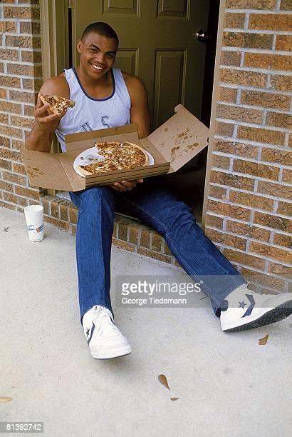College Basketball Closeup casual portrait of Auburn Charles Barkley at home eating pizza Auburn AL 3/2/1984