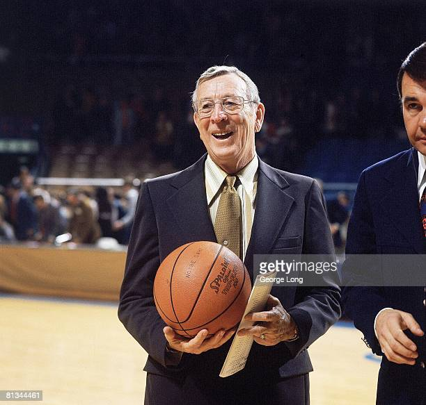 College Basketball Closeup of UCLA coach John Wooden on court with TVS media reporter Dick Enberg before game vs Notre Dame South Bend IN 1/27/1973