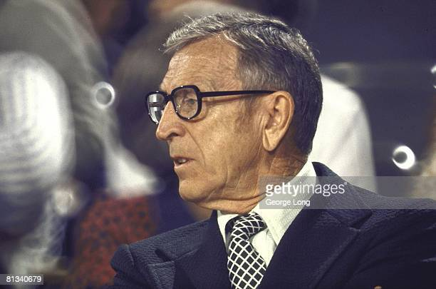 College Basketball Closeup of UCLA coach John Wooden on sidelines during game vs USC Los Angeles CA 2/5/1972
