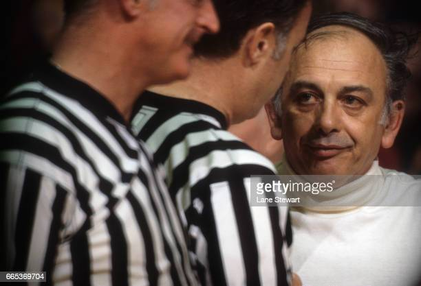 Closeup portrait of Princeton head coach Pete Carril with referee during game vs Colgate at Jadwin Gymnasium Princeton NJ CREDIT Lane Stewart