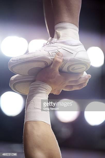 Closeup view of cheerleader's feet being held by hand during Oklahoma vs George Mason game at Lloyd Noble Center Norman OK CREDIT Greg Nelson