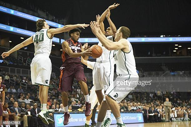 Coaches vs Cancer Classic Virginia Tech Adam Smith in action vs Michigan State Dan Chapman Alvin Ellis III and Colby Wollenman at Barclays Center...