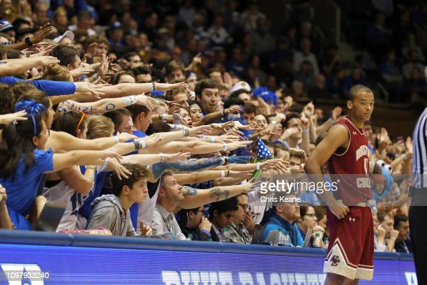 Duke Cameron Crazies fans reaching out to Boston College Steffon Mitchell during game at Cameron Indoor Durham NC CREDIT Chris Keane
