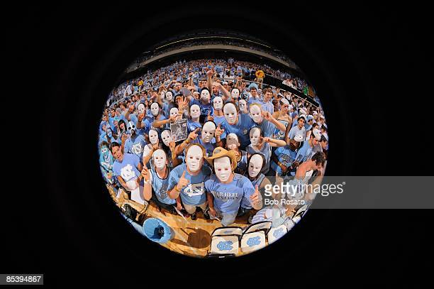 Fish eye view of North Carolina fans in stands wearing white face masks during game vs Duke Chapel Hill NC 3/8/2009 CREDIT Bob Rosato