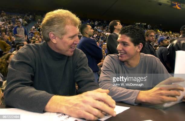 Former UCLA player Bill Walton sitting courtside with his son Chris during game vs Arizona at Pauley Pavilion Bill Walton's other son Luke Walton...