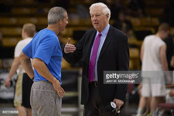 Fox Sports analyst Bill Raftery talking with UCLA assistant coach Ed Schilling before game vs Colorado at Coors Events Center Boulder CO CREDIT John...