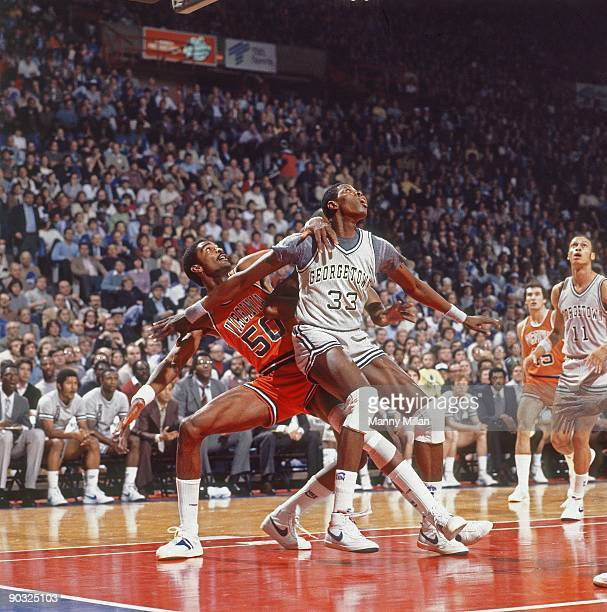 Georgetown Patrick Ewing in action boxing out Virginia Ralph Sampson Landover MD CREDIT Manny Millan