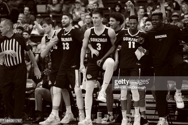 Gonzaga Corey Kispert Killian Tillie Anton Watson Filip Petrusev Ryan Woolridge and Oumar Ballo victorious from bench during game vs San Diego at...