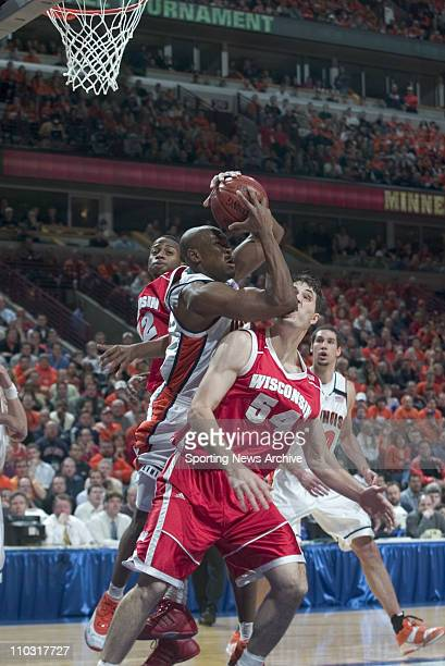 College Basketball Illinois Roger Powell against Wisconsin Alando Tucker Mike Wilkinson during the Big 10 Tournament at the United Center in Chicago...