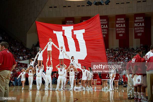 Indiana cheerleaders in pyramid in front of large banner during game vs Ohio State at Assembly Hall Bloomington IN CREDIT Andrew Hancock