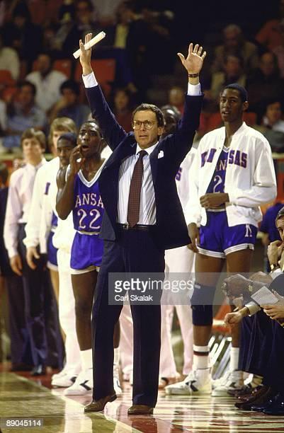 Kansas coach Larry Brown raising his arms on sidelines during game vs Oklahoma Norman OK 1/14/1985 CREDIT Carl Skalak
