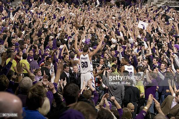 Kansas State Michael Beasley victorious surrounded by fans after winning game vs Kansas Fans rushed the court after win ended a 24year homecourt...