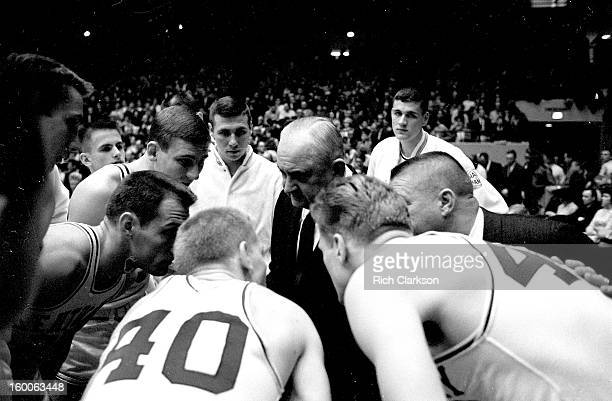 Kentucky coach Adolph Rupp in huddle with players during timeout during game vs Mississippi at Memorial Coliseum Lexington KY 2/22/1964CREDIT Rich...