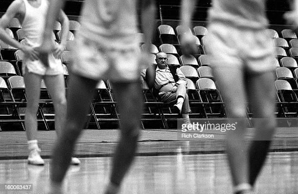 Kentucky coach Adolph Rupp sitting on bench during practice at Memorial Coliseum Lexington KY CREDIT Rich Clarkson