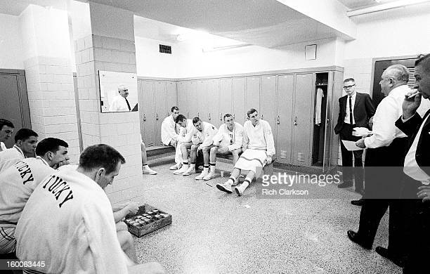 Kentucky coach Adolph Rupp talking to players in locker room before game vs Mississippi at Memorial Coliseum View of his reflection in the mirror...