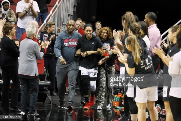 Louisville Asia Durr coming out onto court with her parents on Senior Day before game vs North Carolina State at KFC Yum Center Louisville KY CREDIT...