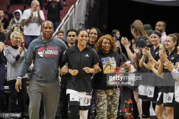 Louisville Asia Durr walking onto court with her parents on Senior Day before game vs North Carolina State at KFC Yum Center Louisville KY CREDIT...