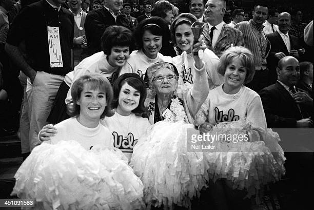 NCAA Final Four Alice Crandell den mother of UCLA athletes victorious with cheerleaders after game vs Michigan at Memorial Coliseum Ma Crandell rings...