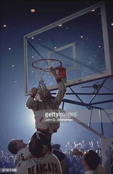 College Basketball NCAA Final Four Cincinnati Larry Shingleton victorious cutting down net after winning championship game vs Ohio State Cover...