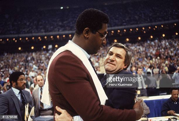 College Basketball: NCAA Final Four, Closeup of North Carolina coach Dean Smith victorious with Georgetown coach John Thompson after game, New...