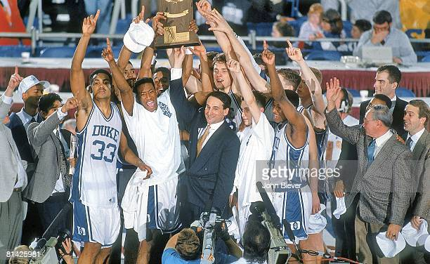 College Basketball: NCAA Final Four, Duke Coach Mike Krzyzewski victorious with team and trophy during celebration after winning championship game vs...