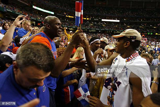 College Basketball NCAA Final Four Florida Al Horford victorious with father Tito Horford and Dominican Republic flag in stands after winning...