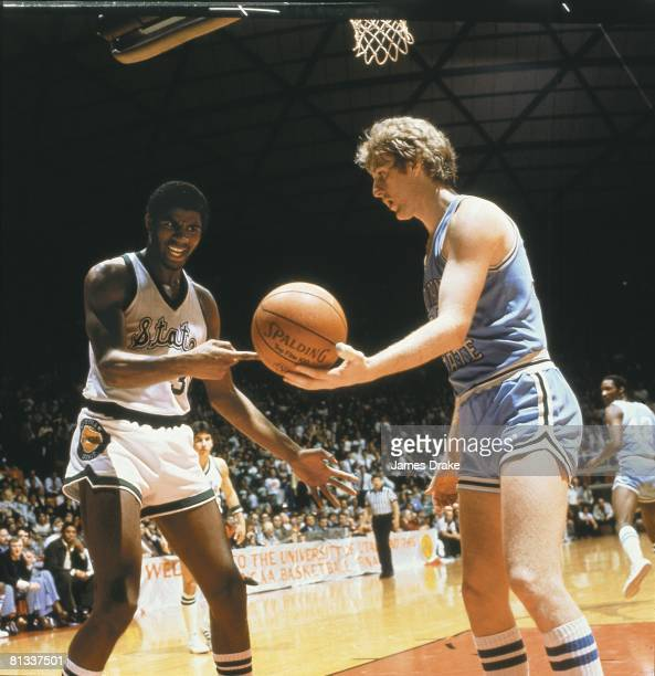 College Basketball: NCAA Final Four, Indiana State Larry Bird handing ball to Michigan State Magic Johnson during championship game, Salt Lake City,...