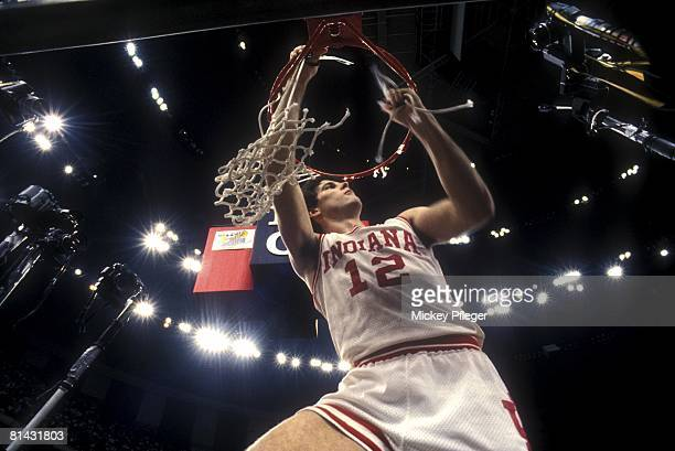 College Basketball: NCAA Final Four, Indiana Steve Alford victorious, cutting down net after winning game and championship vs Syracuse, New Orleans,...