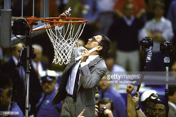 NCAA Final Four Kansas coach Larry Brown on victorious cutting down net after winning championship vs Oklahoma at Kemper Arena Kansas City MO CREDIT...
