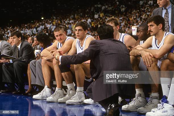 NCAA Final Four Kentucky coach Rick Pitino talking to players on bench during game vs Michigan at Louisiana Superdome View of Kentucky assistant...