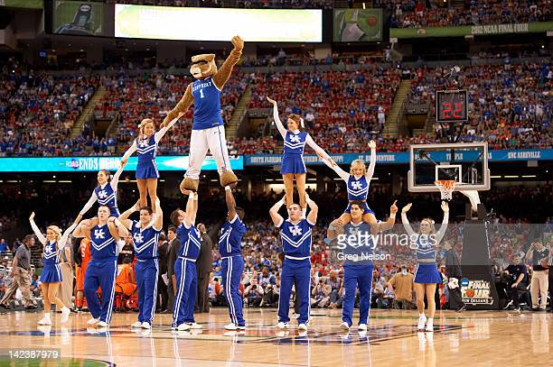 NCAA Final Four Kentucky mascot The Wildcat doing pyramid on court with cheerleaders during game vs Louisville at MercedesBenz Superdome New Orleans...