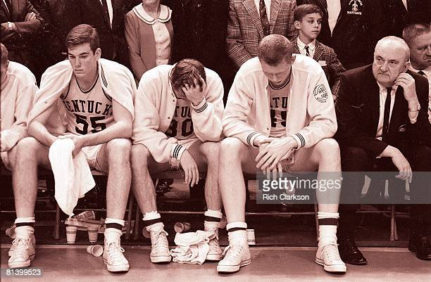 College Basketball NCAA Final Four Kentucky Thad Jaracz Tommy Kron Cliff Berger and coach Adolph Rupp upset on bench during awards ceremony after...