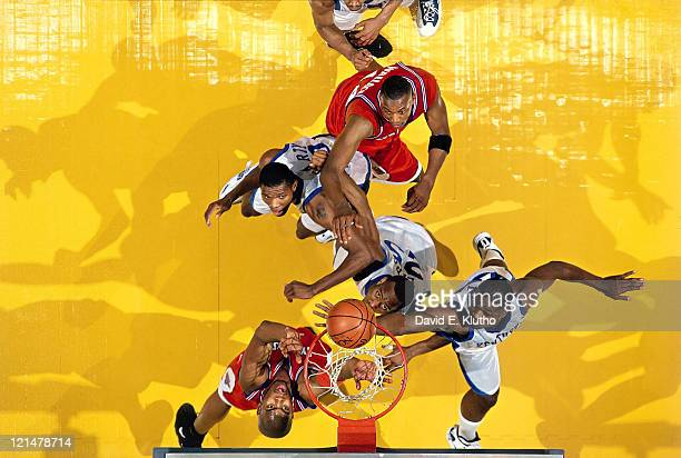 NCAA Final Four Kentucky Walter McCarty Antoine Walker and Anthony Epps in action vs Syracuse Otis Hill at Continental Airlines Arena East Rutherford...