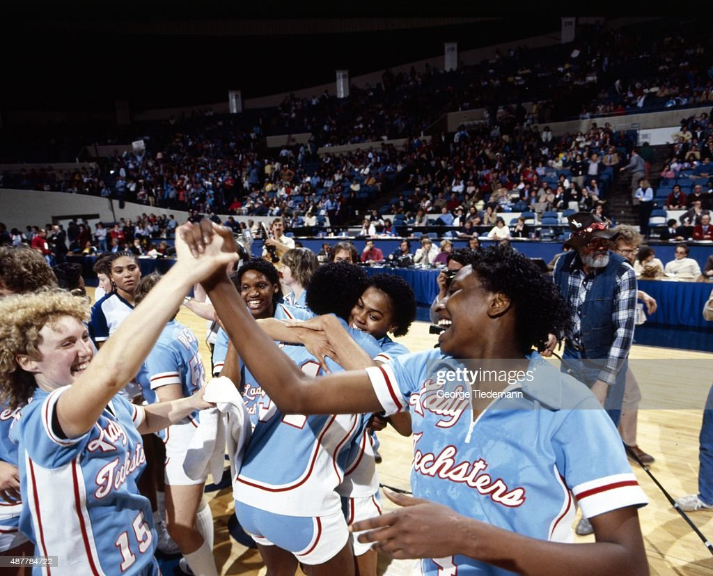 Louisiana Tech players Jennifer White and Debra Rodman victorious on court after winning game vs Cheyney State at the Norfolk Scope. George Tiedemann X26692 )