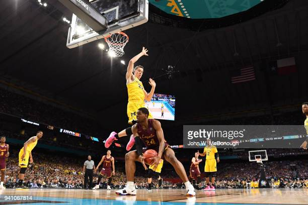 NCAA Final Four Loyola Chicago Aundre Jackson in action vs Michigan Duncan Robinson at Alamodome San Antonio TX CREDIT John W McDonough
