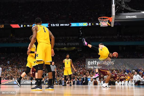 NCAA Final Four Loyola Chicago Aundre Jackson in action vs Michigan Duncan Robinson at Alamodome San Antonio TX CREDIT Greg Nelson