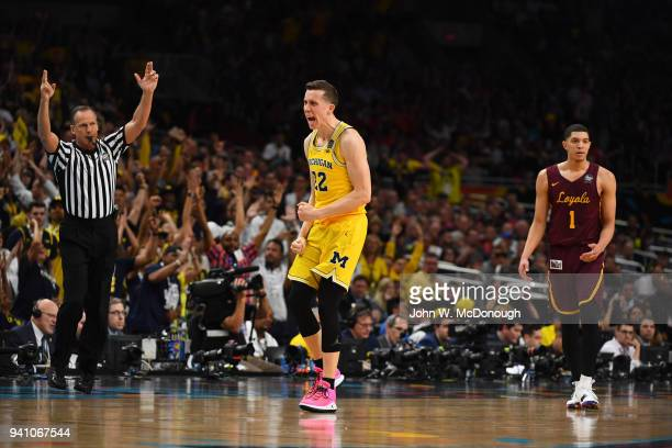 NCAA Final Four Michigan Duncan Robinson victorious during game vs Loyola Chicago at Alamodome San Antonio TX CREDIT John W McDonough