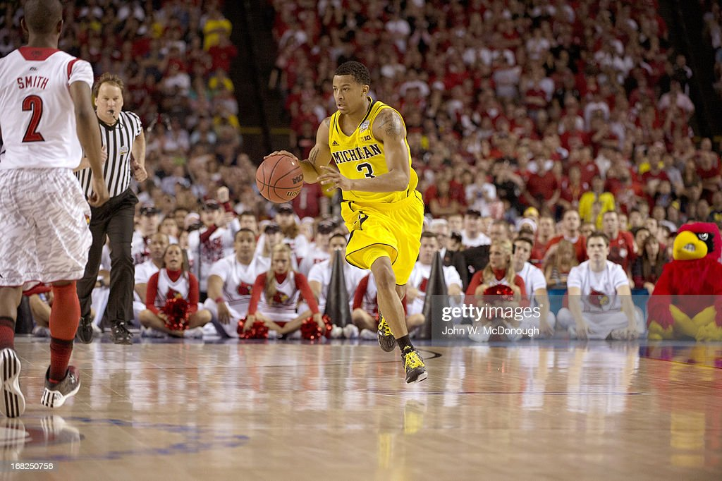 Michigan Trey Burke (3) in action vs Louisville at Georgia Dome. John W. McDonough X156382 TK1 R29 F181 )