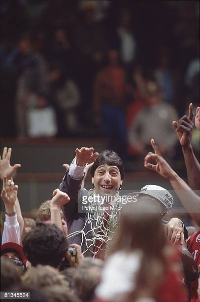 College Basketball NCAA Final Four North Carolina State coach Jim Valvano victorious with net after winning game vs Houston Albuquerque NM 4/4/1983