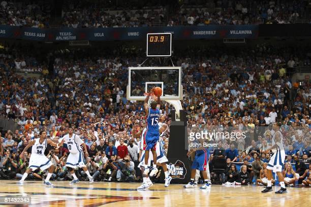 College Basketball NCAA Final Four Rear view of Kansas Mario Chalmers in action making game tying three point shot vs Memphis Derrick Rose Basket...