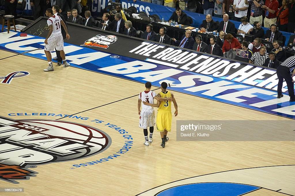 Rear view of Louisville Peyton Siva (3) walking with Michigan Trey Burke (3) after winning game at Georgia Dome. David E. Klutho X156381 TK1 R1 F94 )