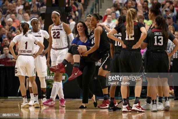 NCAA Final Four Stanford Karlie Samuelson being carried off court during injury during game vs South Carolina at American Airlines Center Dallas TX...