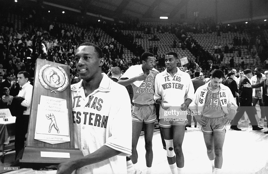 NCAA Final Four, Texas Western players victorious with National Championship trophy after winning game vs Kentucky, College Park, MD 3/19/1966