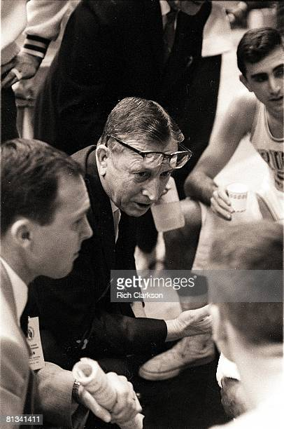 College Basketball NCAA Final Four UCLA coach John Wooden in huddle with team during game vs Kansas State Kansas City MO 3/20/1964