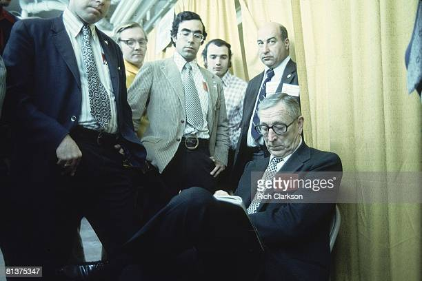 College Basketball NCAA Final Four UCLA coach John Wooden upset in locker room after losing game vs North Carolina State Greensboro NC 3/24/1974